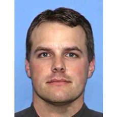 "Police OfficerNicki James ""Nick"" Erfle"